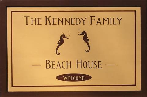 Wooden Beach House sign featuring Sea Horses.