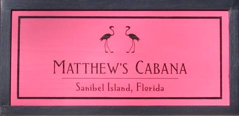 Cabana Signs to personalize featuring pink flamingos.