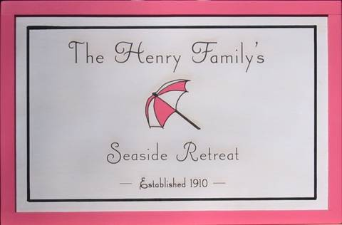Seaside Retreat signs featuring beach umbrella.